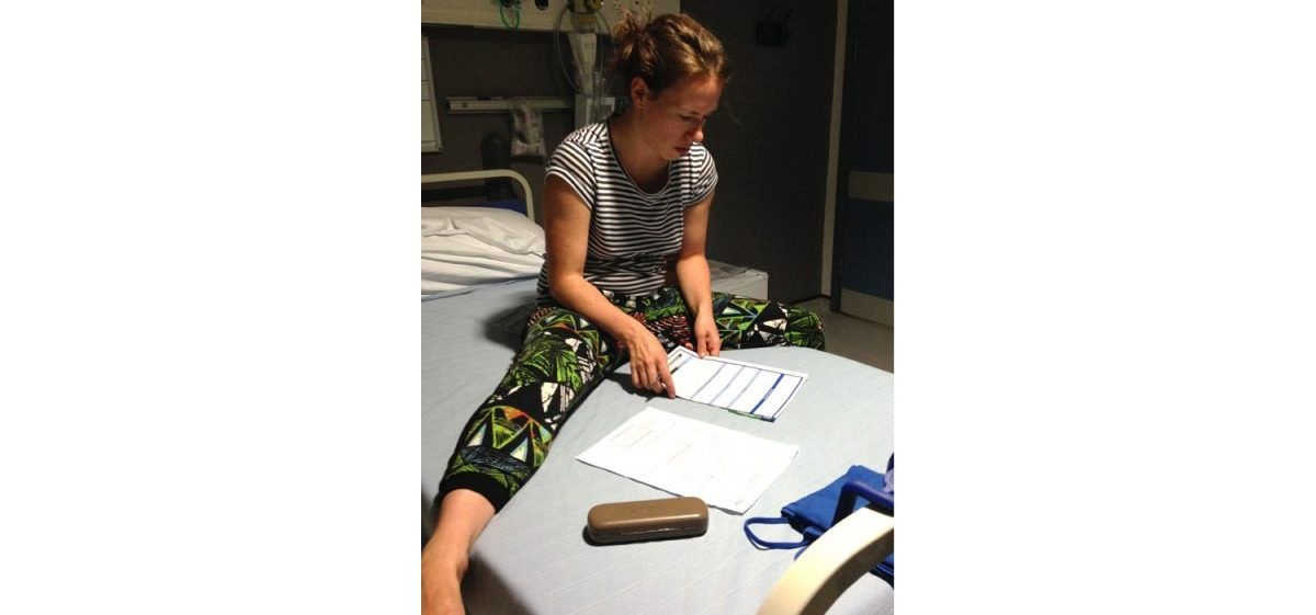 Paperwork in hospital, evening before surgery